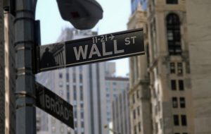 Stocks ended up with a mixed finish on Wall Street Friday after another choppy day of trading, but major indexes still marked their third weekly gains in a row.